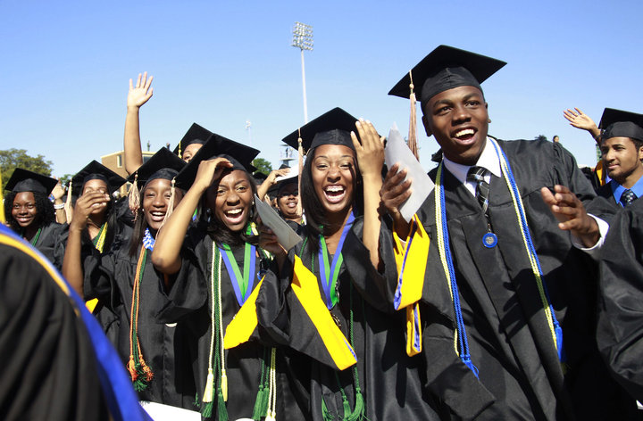 Students react during the graduation ceremony of the 2010 class at Hampton University in Virginia May 9, 2010. U.S. President Barack Obama delivered the commencement address at the graduation and was conferred an honorary doctor of laws degree.     REUTERS/Jason Reed   (UNITED STATES - Tags: POLITICS EDUCATION IMAGES OF THE DAY)